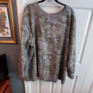 Woman within camo sweatshirt